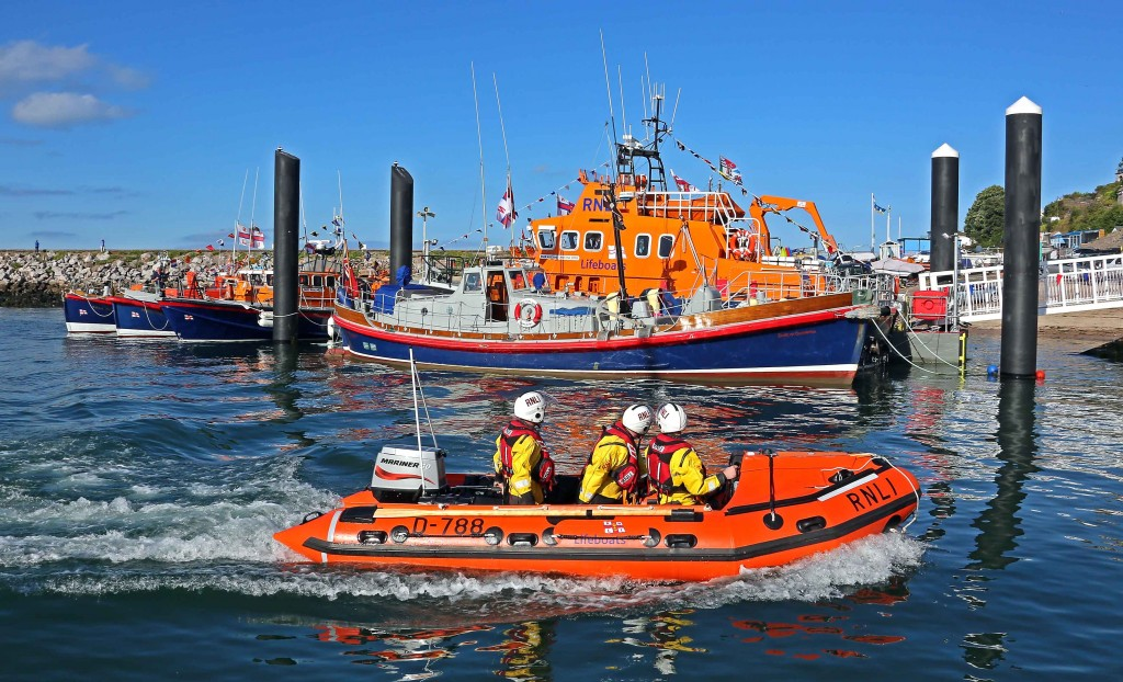 Torbay's new D class lifeboat with the all-weather lifeboat and old lifeboats in the background © RNLI